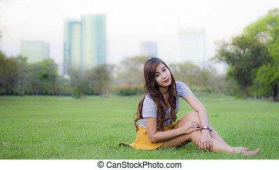 Woman smiling happy sitting in park