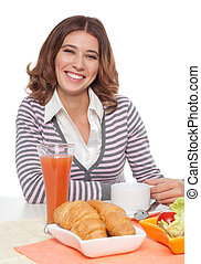 Woman smiling having breakfast