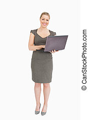 Woman smiling holding a laptop
