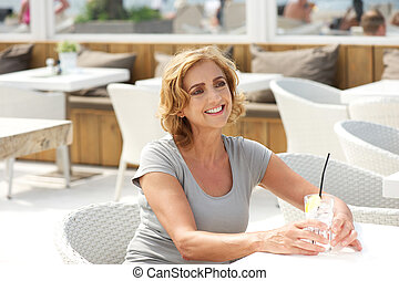 Woman smiling in restaurant with glass of water