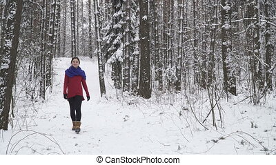 woman smiling in winter forest