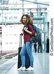 Woman smiling on train station platform