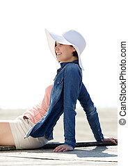 Woman smiling outdoors with sun hat