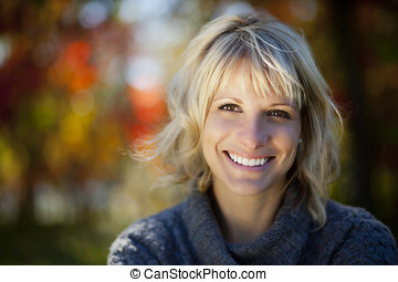 Woman smiling outside