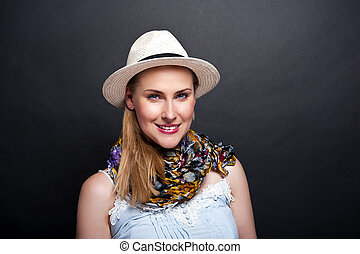 woman smiling over dark background