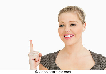 Woman smiling pointing something