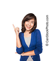 Woman smiling pointing up showing copy space.