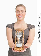 Woman smiling showing a hourglass