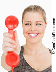 Woman smiling showing a retro phone