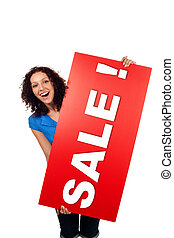 Woman smiling showing red sale sign billboard isolated -...