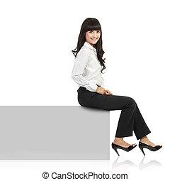Woman smiling sitting on horizontal banner edge. Happy...