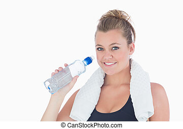 Woman smiling wanting to drink water