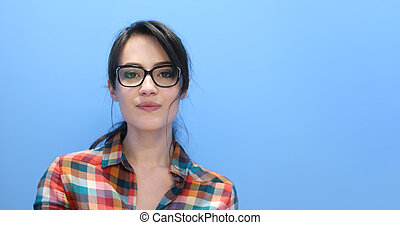 woman smiling wearing on a pair of large glasses