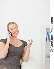Woman smiling while calling someone