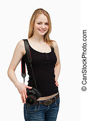 Woman smiling while carrying a camera