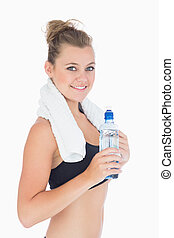 Woman smiling while holding a bottle
