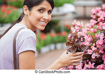 Woman smiling while holding a flower