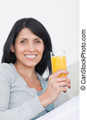 Woman smiling while holding a glass