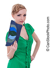 Woman smiling while holding purse