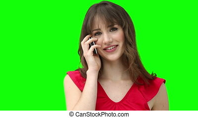 Woman smiling while talking on a cellphone