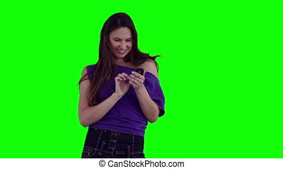 Woman smiling while typing on her phone