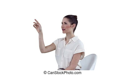 Woman smiling while using a virtual touchscreen