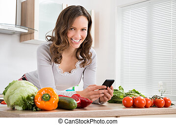 Woman Smiling While Using Mobile Phone
