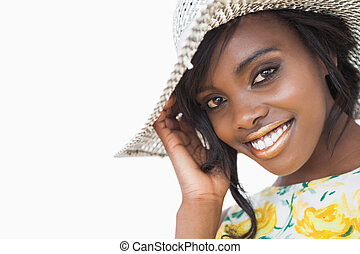 Woman smiling while wearing a summer hat