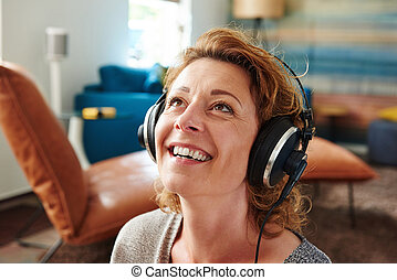 Woman smiling while wearing headphones