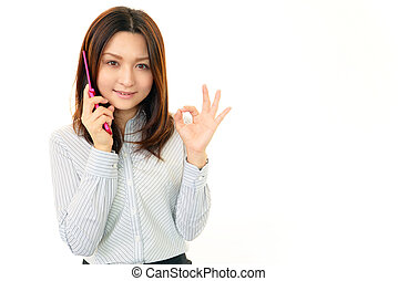Woman smiling with a mobile phone