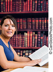 Woman smiling with book