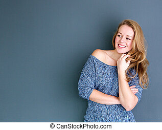 Woman smiling with hand in hair