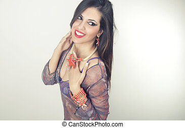 Woman smiling with perfect smile wearing jewelry