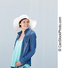 Woman smiling with white sun hat