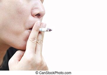 Woman smokes a cigarette