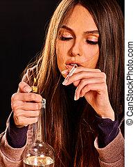 Woman smokes cigarette.