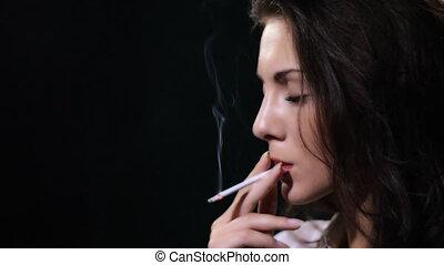 woman smokes cigarette
