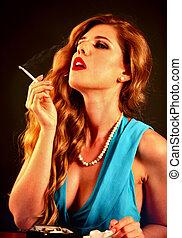 Woman smokes marijuana. Girl who smokes cigarette.