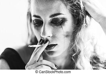 Woman smokes