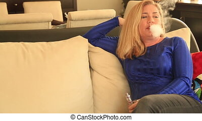 Woman smoking an electronic cigarette