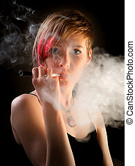 Elegant woman with eccentric hairstyle smoking e-cigarette with smoke