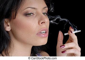 woman smoking on black background