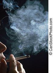 woman smoking  - detail of a woman smoking a cigarette