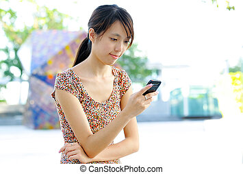 woman sms on mobile phone