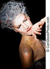 Woman smudging lipstick