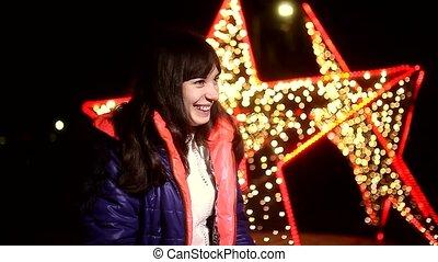 woman  sneezing into a handkerchief cold influenza winter night stars bokeh