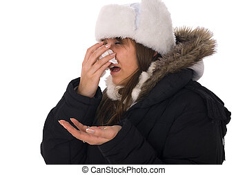 Woman sneezing - Young woman have head cold and holding...