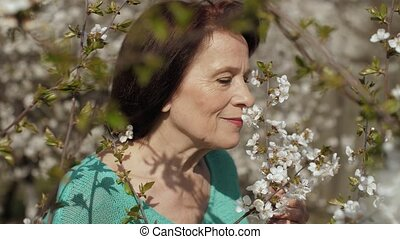 Portrait of middle aged woman on nature