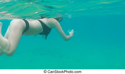 Woman snorkeling in amazing sea in slow motion