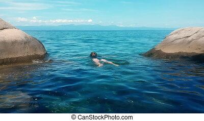 Woman Snorkelling in Lake Malawi with Panoramic Waterscape...
